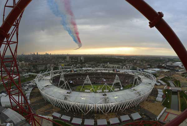 The Red Arrows aerobatic team flies over the Olympic Stadium during the Opening Ceremony at the 2012 Summer Olympics, Friday, July 27, 2012, in London. &#40;AP Photo&#47;Mark J. Terrill&#41; <span class=meta>(AP Photo&#47; Mark J. Terrill)</span>