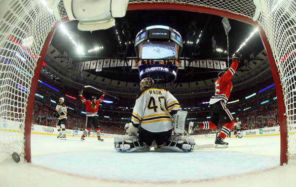 Chicago Blackhawks center Andrew Shaw, right, celebrates as he scores the game winning goal against Boston Bruins goalie Tuukka Rask &#40;40&#41; during the third overtime period of Game 1 in their NHL Stanley Cup Final hockey series, Wednesday, June 12, 2013, in Chicago. The Blackhawks won 4-3. &#40;AP Photo&#47;Bruce Bennett, Pool&#41; <span class=meta>(AP Photo&#47; Bruce Bennett)</span>