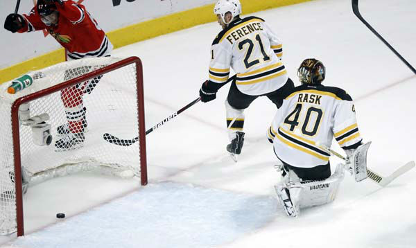 Boston Bruins goalie Tuukka Rask &#40;40&#41; and Boston Bruins defenseman Andrew Ference &#40;21&#41; watch as the puck slides into the goal shot by Chicago Blackhawks defenseman Johnny Oduya during the third period of Game 1 in their NHL Stanley Cup Final hockey series, Wednesday, June 12, 2013 in Chicago. &#40;AP Photo&#47;Charles Rex Arbogast&#41; <span class=meta>(AP Photo&#47; Charles Rex Arbogast)</span>