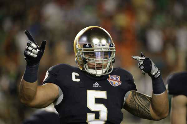 "<div class=""meta image-caption""><div class=""origin-logo origin-image ""><span></span></div><span class=""caption-text"">Notre Dame linebacker Manti Te'o (5) warms up before the BCS National Championship college football game Alabama, Monday, Jan. 7, 2013, in Miami. (AP Photo/David J. Phillip) (AP Photo/ David J. Phillip)</span></div>"