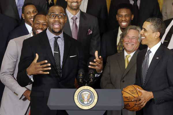 LeBron James speaks as President Barack Obama listens as he honors the NBA champions Miami Heat basketball team in the East Room at the White House in Washington, Monday, Jan. 28, 2013. Also pictured is Dwyane Wade, rear left, behind James. &#40;AP Photo&#47;Charles Dharapak&#41; <span class=meta>(AP Photo&#47; Charles Dharapak)</span>