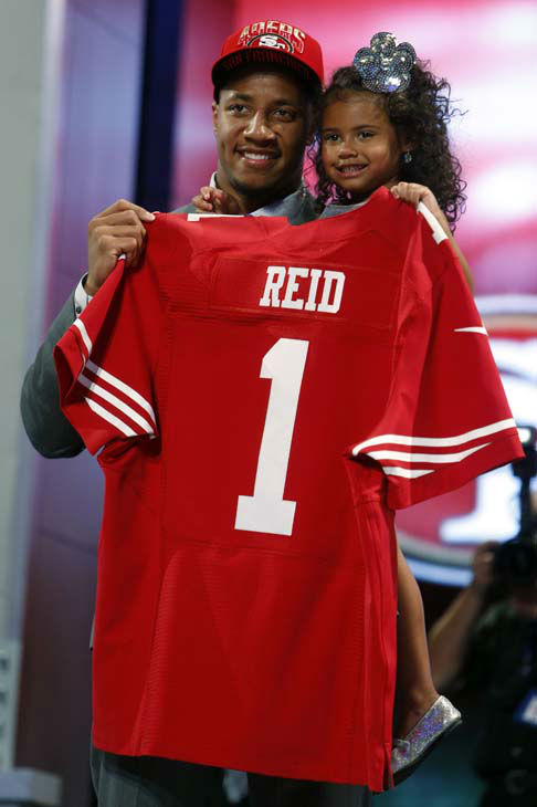 Eric Reid, from Louisiana State, holds up a team jersey and his daughter after being selected 18th overall by the San Francisco 49ers in the first round of the NFL football draft, Thursday, April 25, 2013, at Radio City Music Hall in New York.  &#40;AP Photo&#47;Jason DeCrow&#41; <span class=meta>(AP Photo&#47; Jason DeCrow)</span>