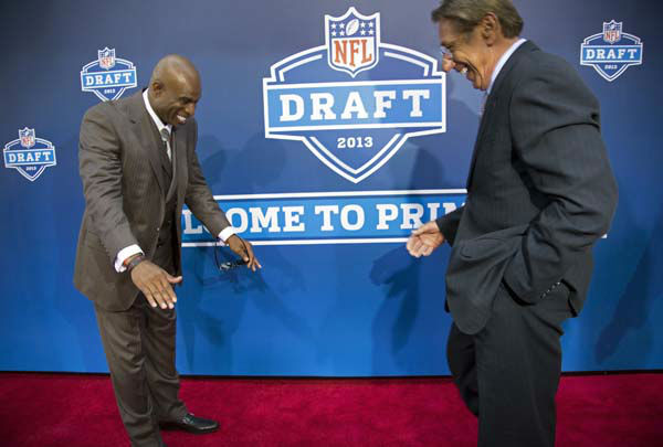 Deion Sanders, left, bows to Joe Namath on the red carpet before the first round of the NFL football draft, Thursday, April 25, 2013, at Radio City Music Hall in New York. &#40;AP Photo&#47;Craig Ruttle&#41; <span class=meta>(AP Photo&#47; Craig Ruttle)</span>
