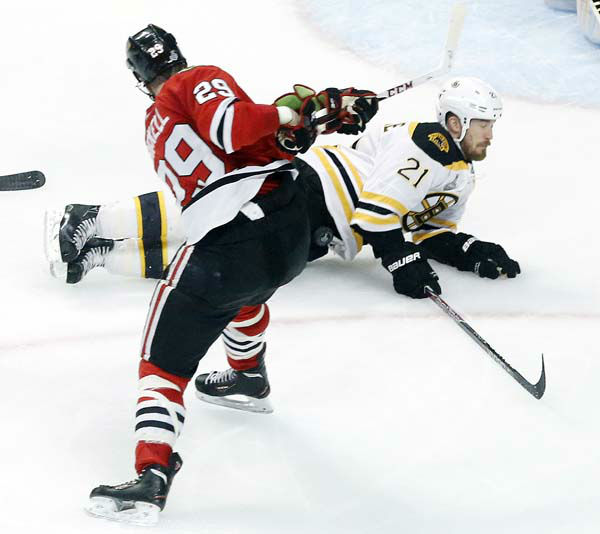 Boston Bruins defenseman Andrew Ference &#40;21&#41; blocks a shot by Chicago Blackhawks left wing Bryan Bickell &#40;29&#41; during the second period of Game 1 in their NHL Stanley Cup Final hockey series on Wednesday, June 12, 2013, in Chicago. &#40;AP Photo&#47;Charles Rex Arbogast&#41; <span class=meta>(AP Photo&#47; Charles Rex Arbogast)</span>