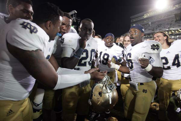 Notre Dame players, including Kendall Moore, left, Cierre Wood &#40;20&#41;, Davonte&#39; Neal &#40;19&#41;, Theo Riddick and Chris Salvi &#40;24&#41; celebrate following a 20-3 win over Michigan State in an NCAA college football game, Saturday, Sept. 15, 2012, in East Lansing, Mich. &#40;AP Photo&#47;Al Goldis&#41; <span class=meta>(AP Photo&#47; Al Goldis)</span>