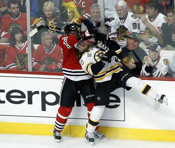 Chicago Blackhawks right wing Marian Hossa &#40;81&#41; checks Boston Bruins left wing Daniel Paille &#40;20&#41; during the first overtime period of Game 1 in their NHL Stanley Cup Final hockey series,Wednesday, June 12, 2013 in Chicago. &#40;AP Photo&#47;Charles Rex Arbogast&#41; <span class=meta>(AP Photo&#47; Charles Rex Arbogast)</span>