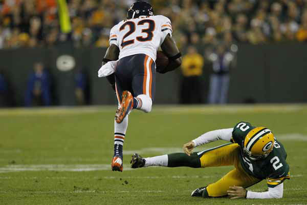 Green Bay Packers kicker Mason Crosby attempts to trip up Chicago Bears wide receiver Devin Hester during a kick off return during an NFL football game Thursday, Sept. 13, 2012, in Green Bay, Wis. &#40;AP Photo&#47;Matt Ludtke&#41; <span class=meta>(AP Photo&#47; Matt Ludtke)</span>