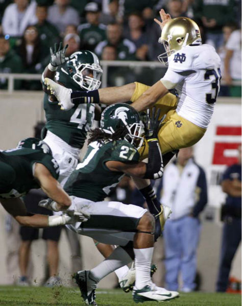 "<div class=""meta image-caption""><div class=""origin-logo origin-image ""><span></span></div><span class=""caption-text"">Michigan State's Kurtis Drummond (27) runs into Notre Dame punter Ben Turk, right, as Michigan State's Ed Davis (43) and Kyler Ellsworth pursue during the third quarter of an NCAA college football game, Saturday, Sept. 15, 2012, in East Lansing, Mich. The penalty gave the ball back to Notre Dame. Notre Dame won 20-3. (AP Photo/Al Goldis) (AP Photo/ Al Goldis)</span></div>"