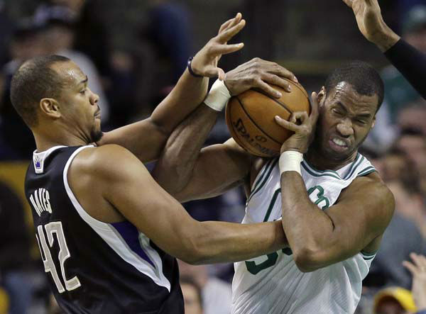 Boston Celtics center Jason Collins, right, struggles for control of the ball with Sacramento Kings forward Chuck Hayes &#40;42&#41; during the second half of an NBA basketball game in Boston, Wednesday, Jan. 30, 2013. The Celtics won 99-81. &#40;AP Photo&#47;Elise Amendola&#41; <span class=meta>(AP Photo&#47; Elise Amendola)</span>
