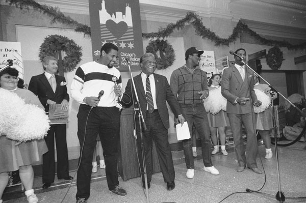 "Chicago Mayor Harold Washington, center, laughs on Monday, Dec. 16, 1985 at City Hall as Chicago Bears' Richard Dent, left, and Otis Wilson, right, teach him a ""Super Bowl Shuffle.""  (AP Photo/Charlie Bennett)"