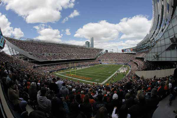 In this photo taken with a fisheye lens, fans watch the action between the Chicago Bears and the St. Louis Rams in the first half of an NFL football game in Chicago, Sunday, Sept. 23, 2012. &#40;AP Photo&#47;Kiichiro Sato&#41; <span class=meta>(AP Photo&#47; Kiichiro Sato)</span>