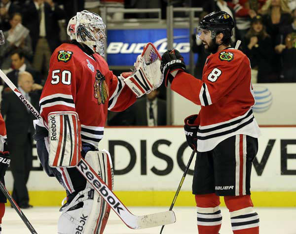 "<div class=""meta ""><span class=""caption-text "">Chicago Blackhawks goalie Corey Crawford (50) celebrates with defenseman Nick Leddy (8) during the third overtime period of Game 1 in their NHL Stanley Cup Final hockey series, Thursday, June 13, 2013, in Chicago. (AP Photo/Nam Y. Huh) (AP Photo/ Nam Y. Huh)</span></div>"