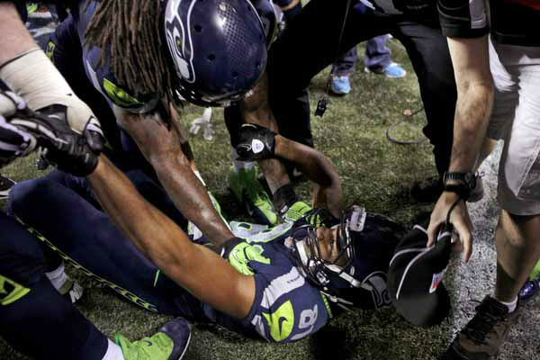 Seattle Seahawks wide receiver Golden Tate is pulled from the end zone by wide receiver Sidney Rice after scoring the winning touchdown against the Green Bay Packers in the fourth quarter of an NFL football game, Monday, Sept. 24, 2012, in Seattle. The Seahawks won 14-12. &#40;AP Photo&#47;Stephen Brashear&#41; <span class=meta>(AP Photo&#47; Stephen Brashear)</span>
