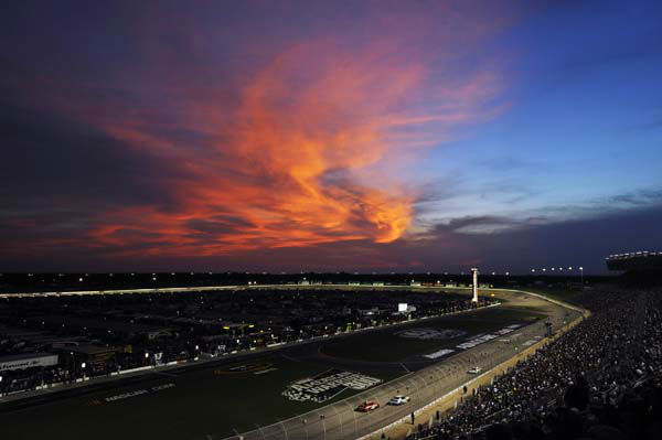 The sun sets behind clouds during the NASCAR Sprint Cup Series auto race at Atlanta Motor Speedway, Sunday, Sept. 2, 2012, in Hampton, Ga. &#40;AP Photo&#47;Rainier Ehrhardt&#41; <span class=meta>(AP Photo&#47; Rainier Ehrhardt)</span>