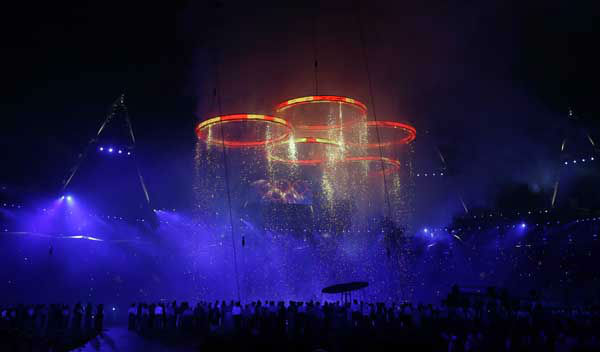 The Olympic rings come together during the Opening Ceremony at the 2012 Summer Olympics, Friday, July 27, 2012, in London. &#40;AP Photo&#47;Matt Slocum&#41; <span class=meta>(AP Photo&#47; Matt Slocum)</span>