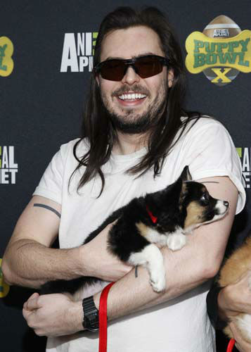IMAGE DISTRIBUTED FOR DISCOVERY COMMUNICATIONS - Andrew W.K. of Animal Planet&#39;s Lil BUB&#39;s special special attends the Puppy Bowl X at the Discovery Times Square Experience in New York on Tuesday, Jan. 28, 2014. &#40;Mark Von Holden&#47;AP Images for Discovery Communications&#41; <span class=meta>(WLS Photo&#47; Mark Von Holden)</span>