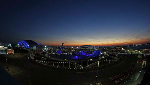 The sun sets over the Olympic Park before the opening ceremony of the 2014 Winter Olympics in Sochi, Russia, Friday, Feb. 7, 2014. &#40;AP Photo&#47;Julio Cortez&#41; <span class=meta>(Photo&#47;Julio Cortez)</span>