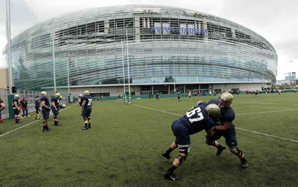 Navy football players training at the Aviva Stadium, Dublin, Ireland, Thursday, Aug. 30, 2012.  American college football team Notre Dame play the Navy team on Saturday in Dublin.  &#40;AP Photo&#47;Peter Morrison&#41; <span class=meta>(AP Photo&#47; Peter Morrison)</span>