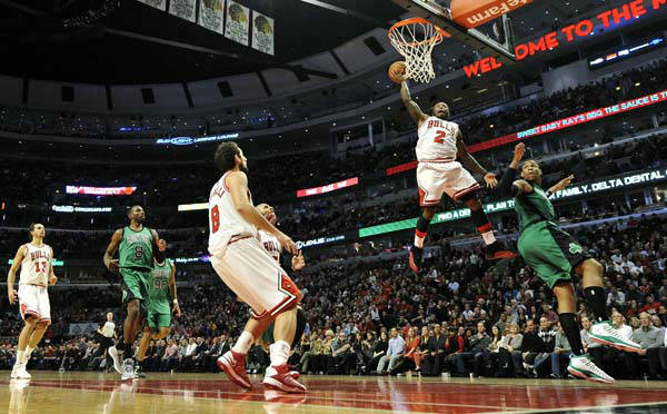 Chicago Bulls guard Nate Robinson &#40;2&#41; shoots against Boston Celtics forward Jared Sullinger, right, during the fourth quarter of an NBA basketball game, Tuesday, Dec. 18, 2012, in Chicago. Bulls center Joakim Noah &#40;13&#41;, Celtics forward Jeff Green &#40;8&#41;, center Jason Collins &#40;98&#41;, Bulls guard Marco Belinelli &#40;8&#41;, of Italy, and forward Carlos Boozer &#40;5&#41; watch the play. The Bulls won 100-89. &#40;AP Photo&#47;Brian Kersey&#41; <span class=meta>(AP Photo&#47; Brian Kersey)</span>