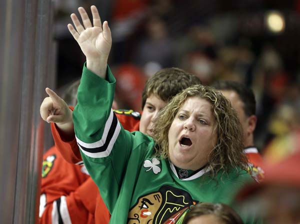 "<div class=""meta ""><span class=""caption-text "">Chicago Blackhawks fans cheer during the second period of Game 1 in the NHL Stanley Cup Final hockey series between the Blackhawks and the Boston Bruins, Wednesday, June 12, 2013, in Chicago. (AP Photo/Nam Y. Huh) (AP Photo/ Nam Y. Huh)</span></div>"