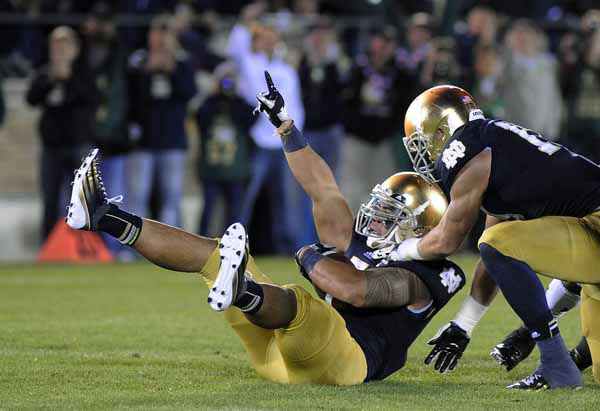 Notre Dame&#39;s Manti Te&#39;o, left, reacts with Zeke Motta after Te&#39;o makes an interception during the first half of an NCAA college football game against Michigan Saturday, Sept. 22, 2012, in South Bend, Ind. &#40;AP Photo&#47;Joe Raymond&#41; <span class=meta>(AP Photo&#47; Joe Raymond)</span>