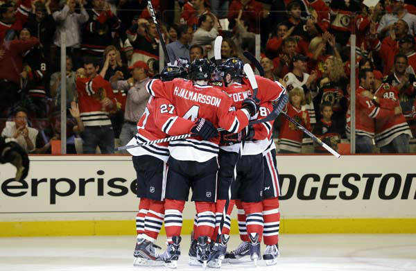 Chicago Blackhawks players celebrate after Chicago Blackhawks left wing Brandon Saad &#40;20&#41; scored a goal against the Boston Bruins during the second period of Game 1 in their NHL Stanley Cup Final hockey series, Wednesday, June 12, 2013, in Chicago. &#40;AP Photo&#47;Nam Y. Huh&#41; <span class=meta>(AP Photo&#47; Nam Y. Huh)</span>