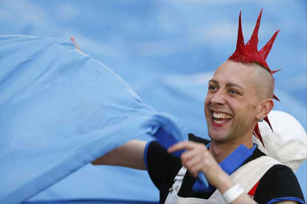 A performer smiles during the Opening Ceremony at the 2012 Summer Olympics, Friday, July 27, 2012, in London. &#40;AP Photo&#47;Matt Dunham&#41; <span class=meta>(AP Photo&#47; Matt Dunham)</span>