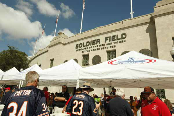 Fans go through security at Soldier Field before an NFL football game between the Chicago Bears and Indianapolis Colts in Chicago, Sunday, Sept. 9, 2012. &#40;AP Photo&#47;Sitthixay Ditthavong&#41; <span class=meta>(AP Photo&#47; Sitthixay Ditthavong)</span>