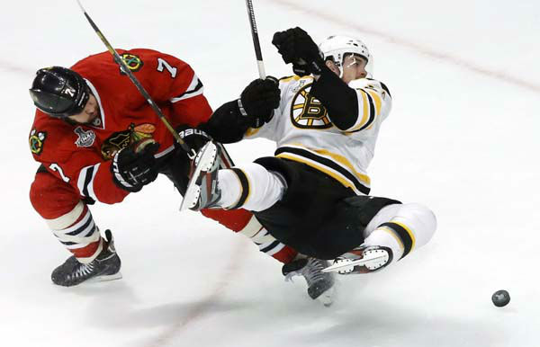 Boston Bruins left wing Daniel Paille, right, shoots as he collides with Chicago Blackhawks defenseman Brent Seabrook during the third period of Game 1 in their NHL Stanley Cup Final hockey series on Wednesday, June 12, 2013, in Chicago. &#40;AP Photo&#47;Charles Rex Arbogast&#41; <span class=meta>(AP Photo&#47; Charles Rex Arbogast)</span>