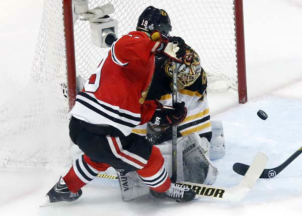 Boston Bruins goalie Tuukka Rask, right, blocks a shot by Chicago Blackhawks center Jonathan Toews &#40;19&#41; during the third period of Game 1 in their NHL Stanley Cup Final hockey series on Wednesday, June 12, 2013, in Chicago. &#40;AP Photo&#47;Charles Rex Arbogast&#41; <span class=meta>(AP Photo&#47; Charles Rex Arbogast)</span>