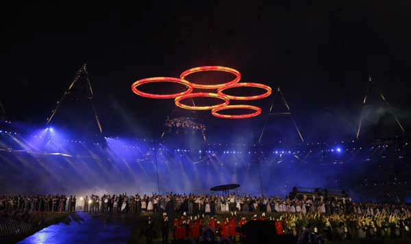 The Olympic rings are illuminated during the Opening Ceremony at the 2012 Summer Olympics, Friday, July 27, 2012, in London.&#40;AP Photo&#47;Matt Slocum&#41; <span class=meta>(AP Photo&#47; Matt Slocum)</span>
