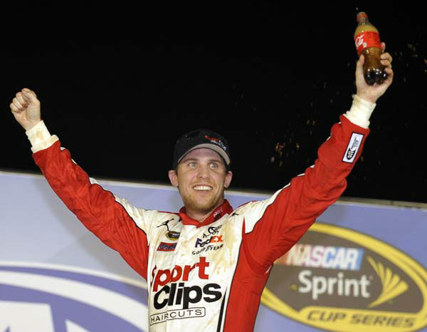 Denny Hamlin celebrates in Victory Lane after winning the NASCAR Sprint Cup Series auto race at Atlanta Motor Speedway, Sunday, Sept. 2, 2012, in Hampton, Ga. &#40;AP Photo&#47;Rainier Ehrhardt&#41; <span class=meta>(AP Photo&#47; Rainier Ehrhardt)</span>