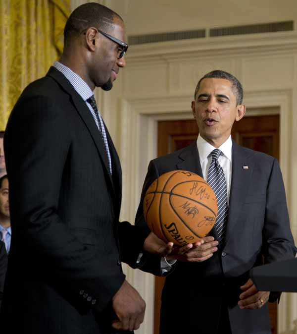 President Barack Obama accepts a signed basketball from Miami Heat forward LeBron James as he welcomes the the NBA basketball champion Miami Heat, to the East Room of the White House, Monday, Jan. 28, 2013, in Washington. &#40;AP Photo&#47;Carolyn Kaster&#41; <span class=meta>(AP Photo&#47; Carolyn Kaster)</span>