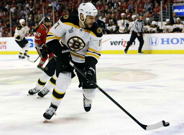 Boston Bruins left wing Milan Lucic &#40;17&#41; controls the puck against Chicago Blackhawks during the first period of Game 1 in their NHL Stanley Cup Final hockey series, Wednesday, June 12, 2013, in Chicago. &#40;AP Photo&#47;Nam Y. Huh&#41; <span class=meta>(AP Photo&#47; Nam Y. Huh)</span>