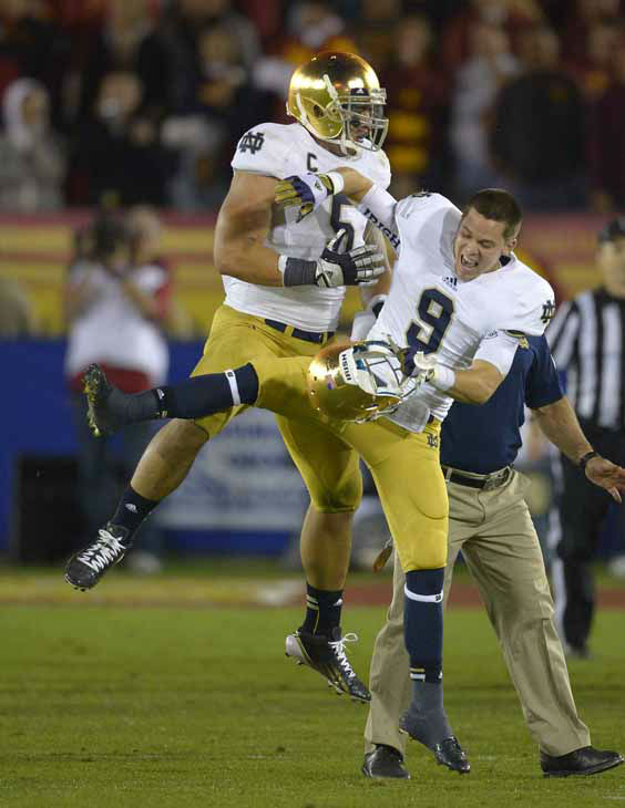 Notre Dame linebacker Manti Te&#39;o, left, celebrates with Notre Dame wide receiver Robby Toma in the closing second of their their NCAA college football game against Southern California, Saturday, Nov. 24, 2012, in Los Angeles. &#40;AP Photo&#47;Mark J. Terrill&#41; <span class=meta>(AP Photo&#47; Mark J. Terrill)</span>