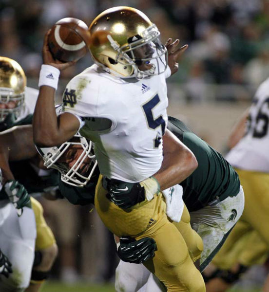 Notre Dame quarterback Everett Golson &#40;5&#41; manages to get off a pass as he is hit by Michigan State&#39;s Max Bullough during the third quarter of an NCAA college football game, Saturday, Sept. 15, 2012, in East Lansing, Mich. Notre Dame won 20-3. &#40;AP Photo&#47;Al Goldis&#41; <span class=meta>(AP Photo&#47; Al Goldis)</span>