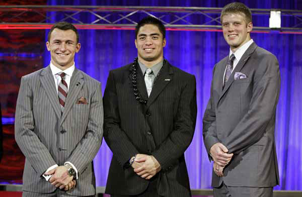 FILE - In this Thursday, Dec. 6, 2012 file photo, from left, Heisman Trophy candidates: Texas A&#38;M&#39;s Johnny Manziel; Notre Dame&#39;s Manti Te&#39;o and Kansas State&#39;s Collin Klein pose for a photo at the Home Depot College Football Awards in Lake Buena Vista, Fla. The Heisman Trophy will be awarded Saturday, Dec. 8, 2012, in New York. &#40;AP Photo&#47;John Raoux, File&#41; <span class=meta>(AP Photo&#47; John Raoux)</span>