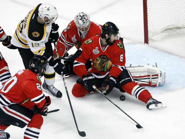 Chicago Blackhawks defenseman Nick Leddy &#40;8&#41; and Chicago Blackhawks goalie Corey Crawford &#40;50&#41; make a save on a shot by Boston Bruins center Tyler Seguin &#40;19&#41; during the first period of Game 1 in their NHL Stanley Cup Final hockey series on Wednesday, June 12, 2013, in Chicago. &#40;AP Photo&#47;Charles Rex Arbogast&#41; <span class=meta>(AP Photo&#47; Charles Rex Arbogast)</span>