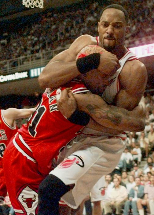 Miami Heat center Alonzo Mourning scuffles with Chicago Bulls forward Dennis Rodman during the fourth quarter of the Eastern Conference finals at the Miami Arena Monday May 26, 1997. The Heat defeated the Bulls 87-80.   (AP  Photo/Jeffrey Boan)