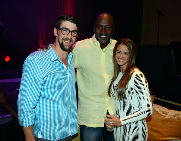 IMAGE DISTRIBUTED FOR JORDAN - From left, former U.S. Olympic swimmer Michael Phelps, Charlotte Bobcats owner Michael Jordan and fiancee model Yvette Prieto attend the Michael Jordan Celebrity Invitational opening night dinner on Wednesday, April 3, 2013 in Las Vegas. &#40;Photo by Jeff Bottari&#47;Invision for Jordan&#47;AP Images&#41; <span class=meta>(AP Photo&#47; Jeff Bottari)</span>