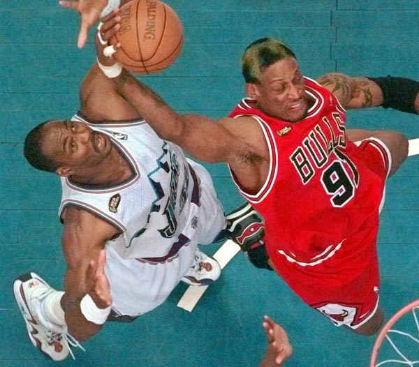 Utah Jazz's Karl Malone, left, tries to steal the ball from Chicago Bulls' Dennis Rodman as he goes to the basket in Game 6 of the NBA Finals in Salt Lake City, Sunday, June 14, 1998. The Bulls defeated the Jazz 87-86 to win their third straight NBA title. (AP Photo/Mark J. Terrill)