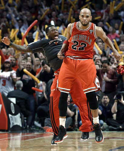 "<div class=""meta ""><span class=""caption-text "">Chicago Bulls forward Taj Gibson (22) celebrates with Nate Robinson after scoring a basket during the second half of an NBA basketball game against the Miami Heat in Chicago on Wednesday, March 27, 2013. The Bulls won 101-97, ending the Heat's 27-game winning streak. (AP Photo/Nam Y. Huh) (AP Photo/ Nam Y. Huh)</span></div>"