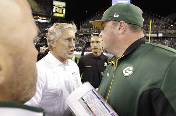 "<div class=""meta ""><span class=""caption-text "">Seattle Seahawks head coach Pete Carroll and Green Bay Packers head coach Mike McCarthy at the end of the NFL football game, Monday, Sept. 24, 2012, in Seattle. The Seahawks won 14-12. (AP Photo/Ted S. Warren) (AP Photo/ Ted S. Warren)</span></div>"