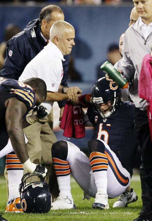 Chicago Bears quarterback Jay Cutler &#40;6&#41; is helped up from the field after he was sacked by Detroit Lions defensive tackle Ndamukong Suh in the first half of an NFL football game in Chicago, Monday, Oct. 22, 2012. &#40;AP Photo&#47;Nam Y. Huh&#41; <span class=meta>(AP Photo&#47; Nam Y. Huh)</span>