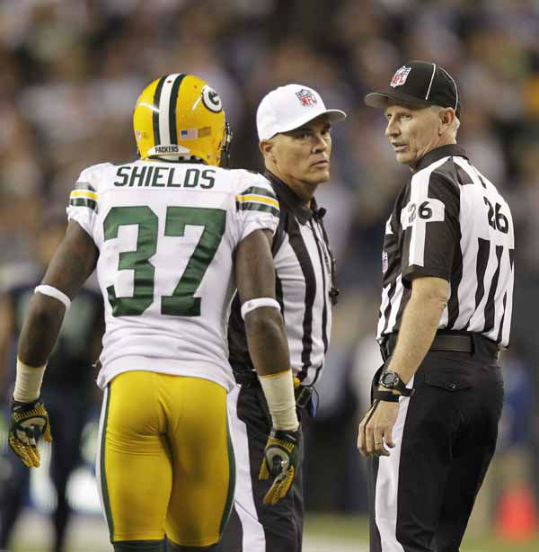 Green Bay Packers Sam Shields watches as two officials talk in the second half of an NFL football game against the Seattle Seahawks, Monday, Sept. 24, 2012, in Seattle. &#40;AP Photo&#47;Stephen Brashear&#41; <span class=meta>(AP Photo&#47; Stephen Brashear)</span>