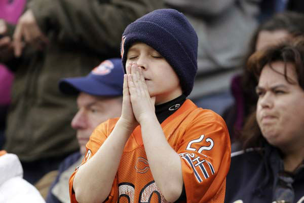 A young Chicago Bears fan gestures during the fourth quarter of an NFL football game against the Seattle Seahawks in Chicago, Sunday, Dec. 2, 2012. The Seahawks won 23-17 in overtime. &#40;AP Photo&#47;Nam Y. Huh&#41; <span class=meta>(AP Photo&#47; Nam Y. Huh)</span>