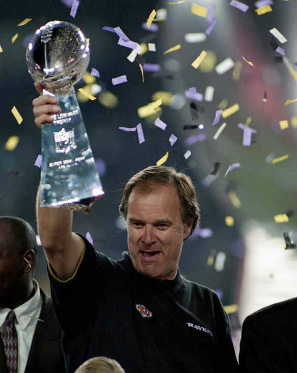"<div class=""meta ""><span class=""caption-text "">Baltimore Ravens head coach Brian Billick holds up the Vince Lombardi trophy after a 34-7 win over the New York Giants in Super Bowl XXXV in Tampa, Fla., Jan. 28, 2001.  (AP Photo/NFL Photos/Paul Spinelli) (AP Photo/ Paul Spinelli)</span></div>"