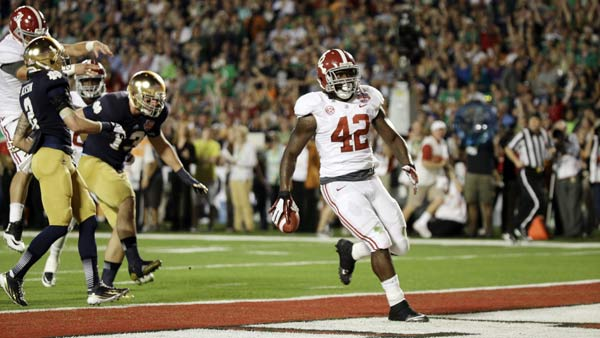 Alabama running back Eddie Lacy (42) scores a touchdown against the Notre Dame during the first half of the BCS National Championship college football game Monday, Jan. 7, 2013, in Miami. (AP Photo/David J. Phillip)