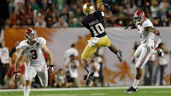 Notre Dame's DaVaris Daniels (10) catches a pass between Alabama's Vinnie Sunseri (3) and Ha'Sean Clinton-Dix during the first half of the BCS National Championship college football game Monday, Jan. 7, 2013, in Miami. (AP Photo/Wilfredo Lee)