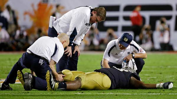 "<div class=""meta ""><span class=""caption-text "">Notre Dame head coach Brian Kelly watches as Kapron Lewis-Moore is worked on during the first half of the BCS National Championship college football game against Alabama Monday, Jan. 7, 2013, in Miami. (AP Photo/David J. Phillip)</span></div>"